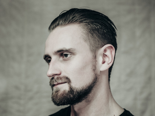 Modern Slicked Back Men's Haircut